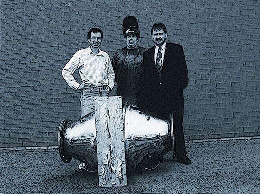 Brick wall with 3 men